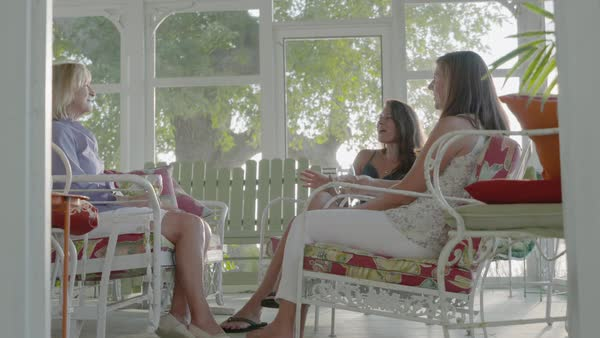 Hand-held shot of three women talking and holding drinks Royalty-free stock video