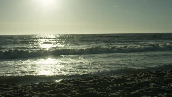 Scenic view of ocean waves moving towards beach during sunset Royalty-free stock video