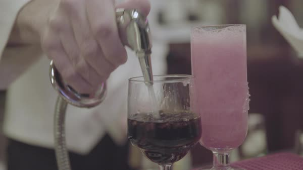 Hand-held shot of a bartender adding soda water to drinks Royalty-free stock video
