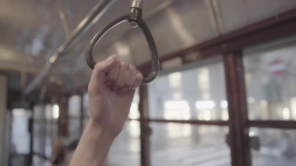 Hand-held shot of a woman holding onto a handle on a tram Royalty-free stock video