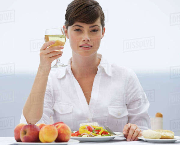 A woman eating alone Royalty-free stock photo