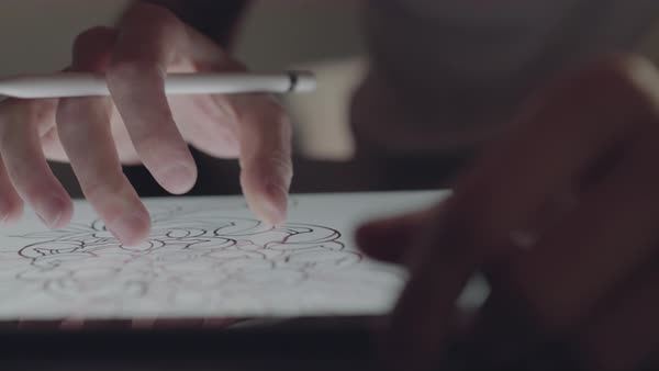 Close-up shot of a tattoo artist drawing a new design on a tablet Royalty-free stock video