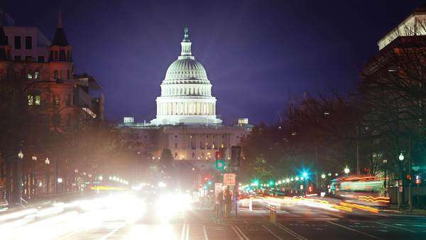 TImelapse of the US Capitol at night with flares and traffic moving. Royalty-free stock video