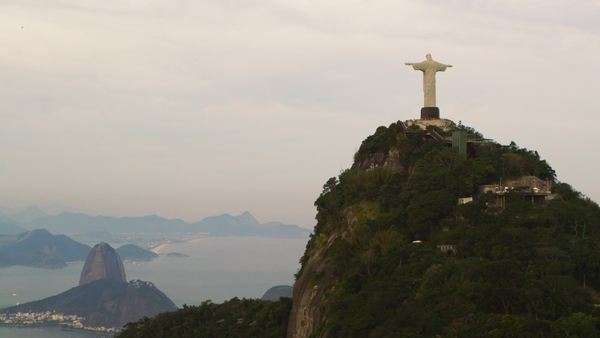 Aerial tracking shot of Cristo Redentor statue in Rio de Janeiro, Brazil taken from a helicopter Royalty-free stock video