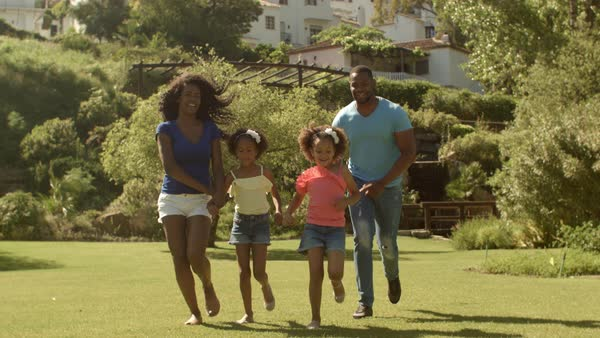 Family running to camera and catching children twirling around Royalty-free stock video