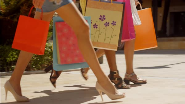 Three women walking with shopping bags in  town legs only Royalty-free stock video