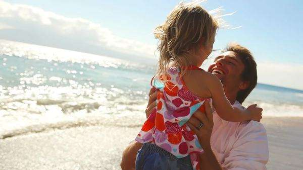 Father and daughter embrace at the beach. Royalty-free stock video