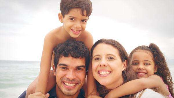 Brazilian family smiles on a beach in Brazil Royalty-free stock video
