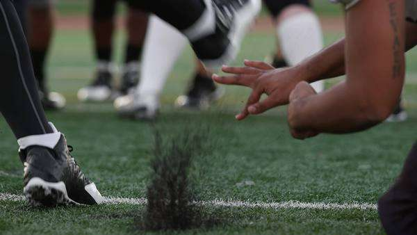Close-up of a football player kicking the ball toward the goal posts Royalty-free stock video