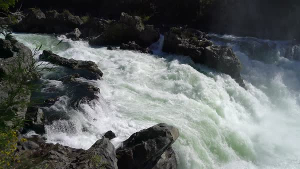 Pan right to whitewater below small falls Royalty-free stock video