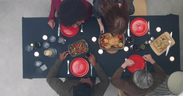 Overhead shot of group of friends having a meal Royalty-free stock video