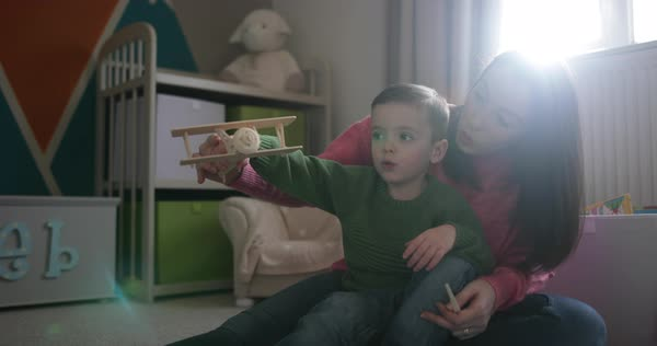 Mother and son playing with toy model plane Royalty-free stock video