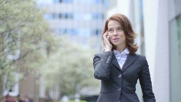 Business Woman makes a call, medium shot Royalty-free stock video