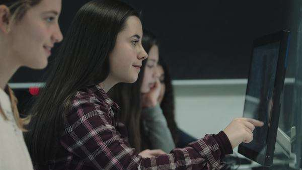 Teenage girls working on computer in technology class Royalty-free stock video