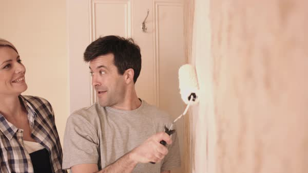 Adult couple painting wall in new home Royalty-free stock video