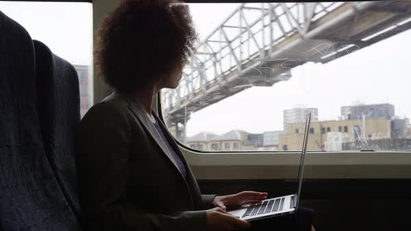 Businesswoman working on laptop whilst on her commute Royalty-free stock video