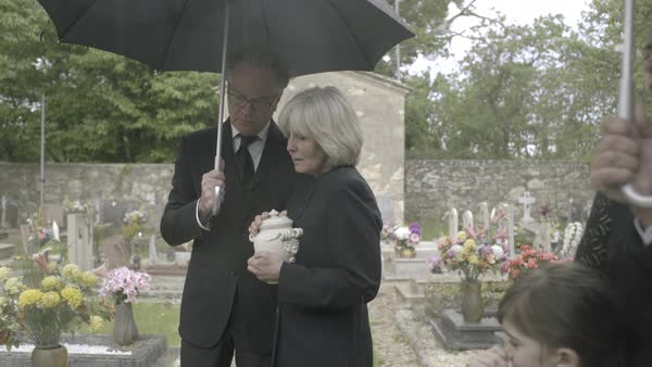 Mourners standing at funeral with cremation urn Royalty-free stock video