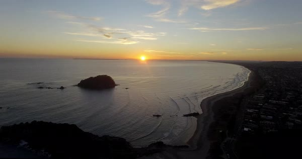 Aerial shot over Tauranga Beach at sunrise with beautiful landscape and ocean in view Royalty-free stock video