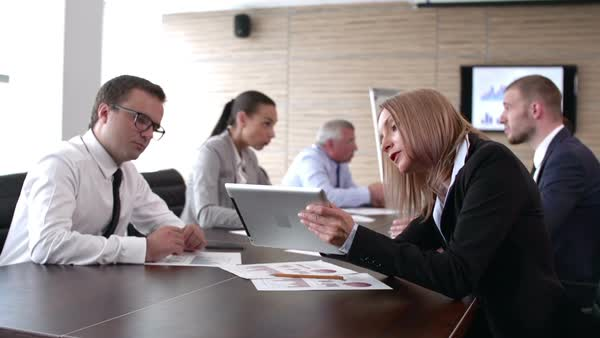 Panoramic shot of business meeting in full swing Royalty-free stock video