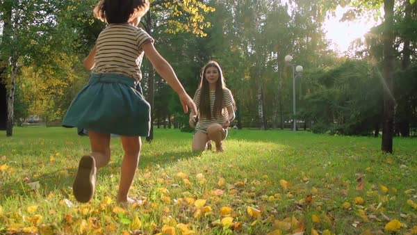 Little girl running to hug her lovely mom in the park Royalty-free stock video