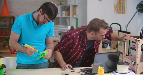 Enthusiastic young men working in their own 3d printing studio  Royalty-free stock video