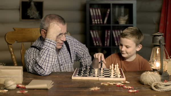 Senior man and his grandson playing chess at home  Royalty-free stock video