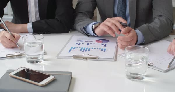 Business team analyzing statistical data and creating business ideas  Royalty-free stock video