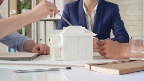 Close-up of architects discussing new house model Royalty-free stock video