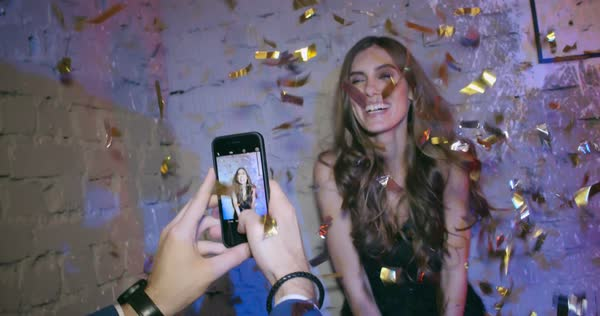 Young man taking pictures of his gorgeous girlfriend at her birthday party  Royalty-free stock video