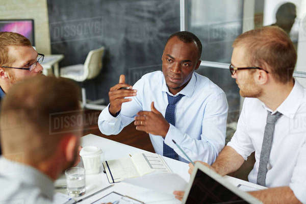 Confident manager explaining his idea to colleagues Royalty-free stock photo