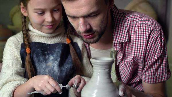 Father and his cute daughter crafting together at the pottery Royalty-free stock video
