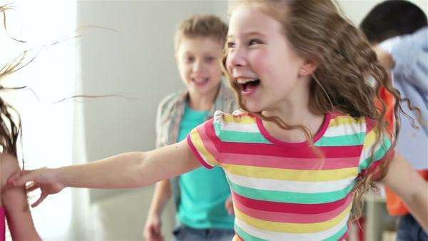 Close-up of children having a pure fun jumping around, slow-motion Royalty-free stock video