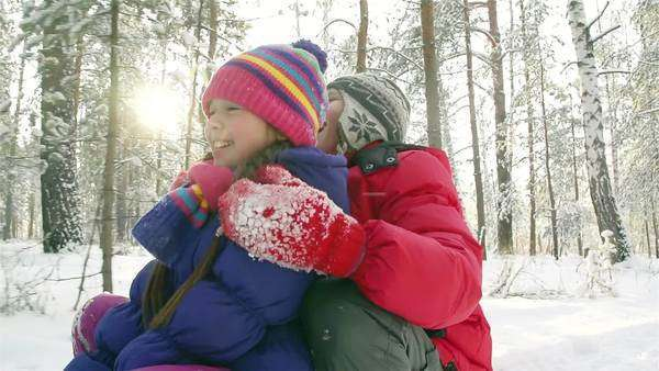 Healthy kids sledding on a sunny winter day Royalty-free stock video