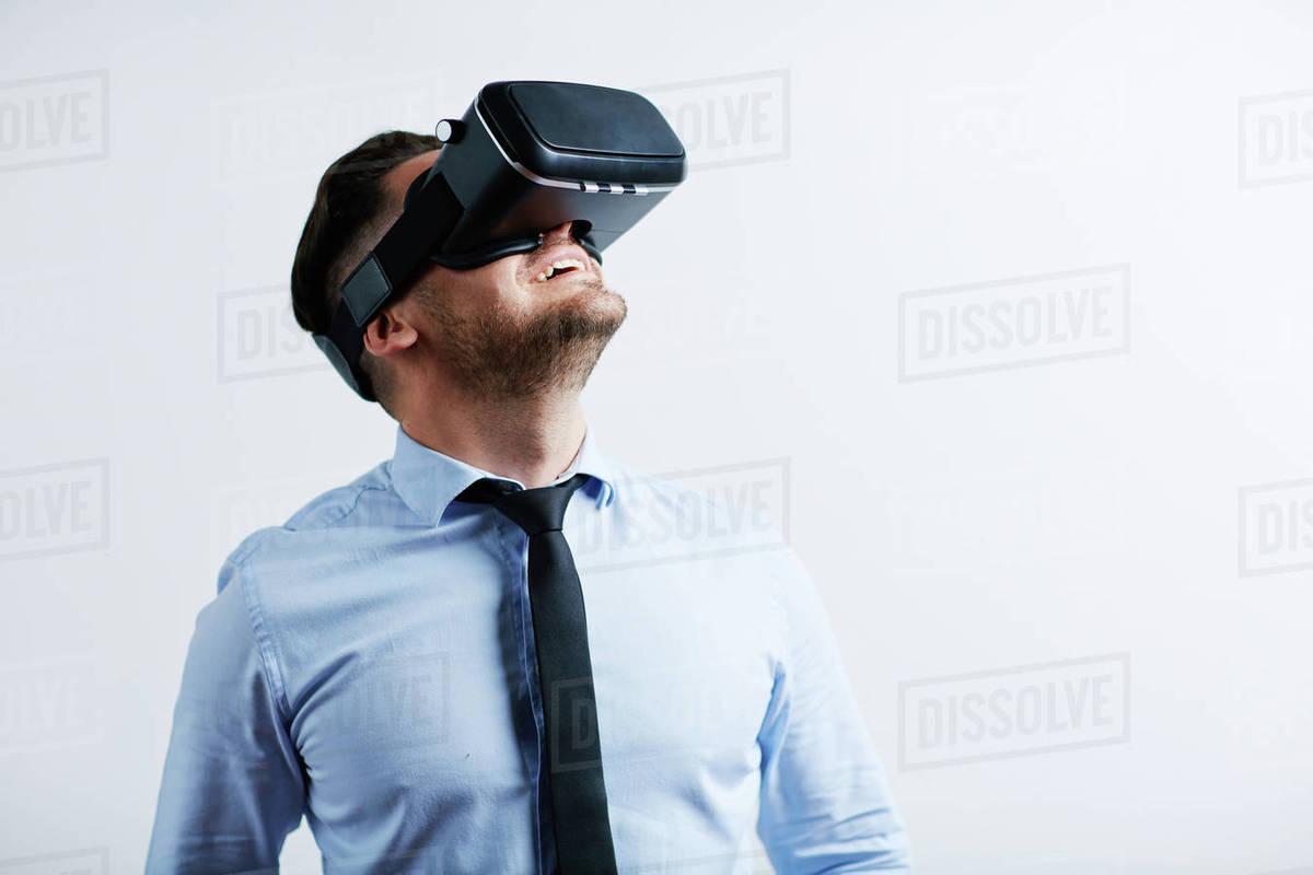 2e660b00cf5 Businessman enjoying virtual reality with simulator - Stock Photo ...
