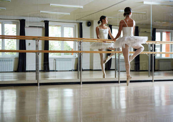 Young ballerina exercising in class in front of mirror Royalty-free stock photo