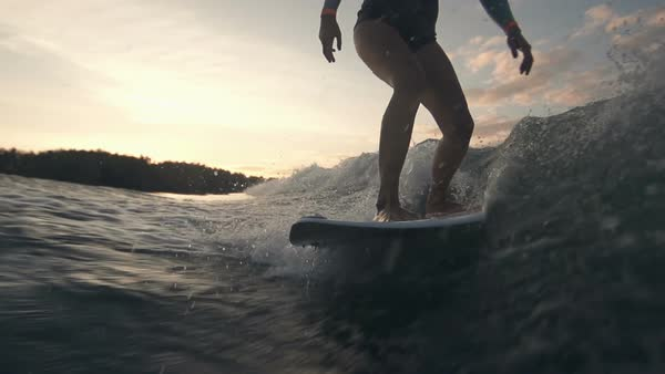 Slow motion of sportive lady surfing in the twilight Royalty-free stock video