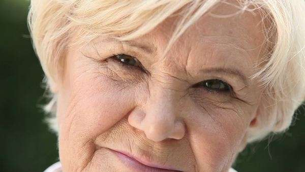 Macro shot of a retired woman with a candid smile Royalty-free stock video