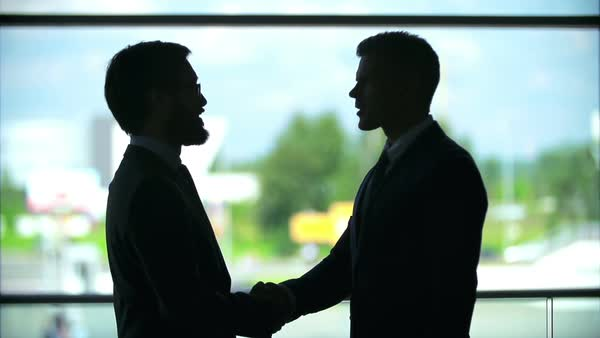 Outlines of two businessmen shaking hands near the window Royalty-free stock video