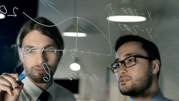 Close up of two business men deriving formula and writing on glass board Royalty-free stock video