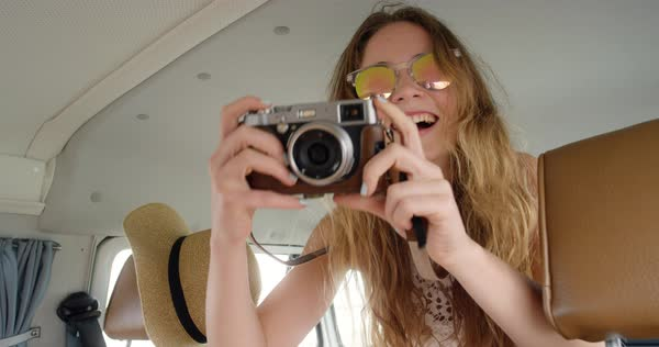 Portrait of beautiful hipster girl taking photos with retro camera Royalty-free stock video