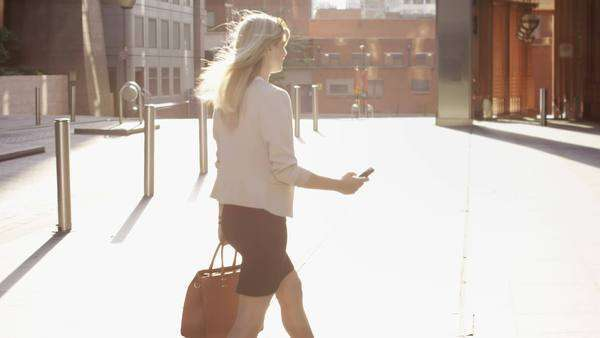Attractive blonde business woman using smartphone commuting in city London Royalty-free stock video