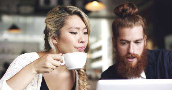 Young couple using digital tablet computer in cafe Royalty-free stock video