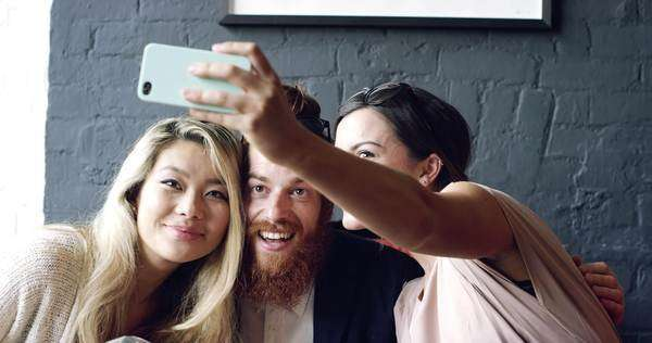 Friends taking selfie photograph self portrait in cafe Royalty-free stock video