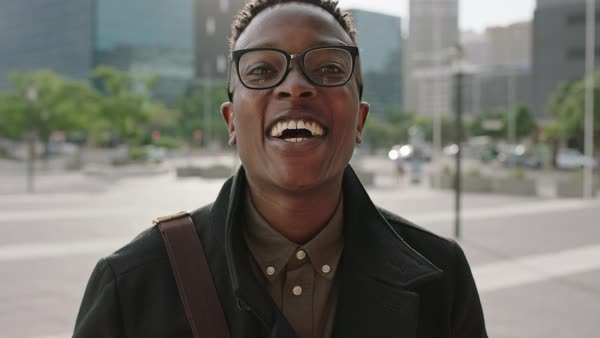 2738f08a7aca Close up portrait of trendy young african american man wearing glasses  laughing cheerful at camera enjoying