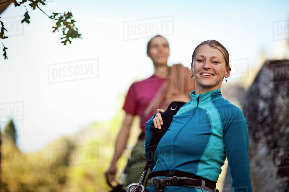 Two backpackers walking on the mountain top. Royalty-free stock photo