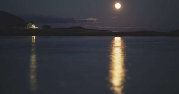 Glowing moon rising above the Lofoten Islands, Norway Royalty-free stock video