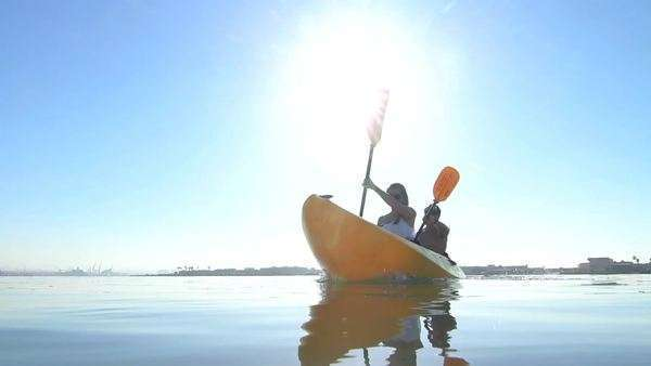 Young Happy Couple Kayaking Outside In Ocean Summer HD Royalty-free stock video