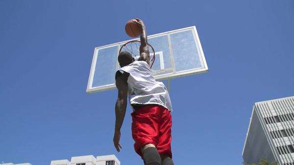 Slow motion basketball player dunking in slow motion Royalty-free stock video
