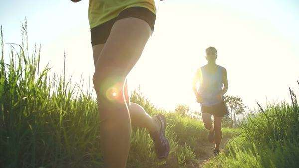 Couple trail running outside at sunset Royalty-free stock video