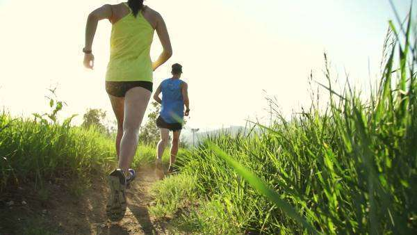 Slow motion couple trail running outside at sunset Royalty-free stock video